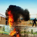 به آتش کشیدن پرچم آمریکا و اسرائیل